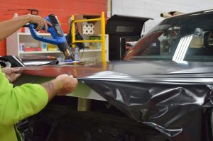Vinyl Wrap Toronto - Vehicle Wrap In Toronto - Heating the vinyl to apply it on the car