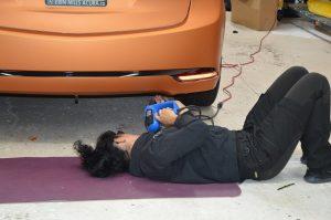 Vinyl Wrap Toronto - Vehicle Wrap In Toronto - Print Shop - Anita 3M Certified Installer doing her job